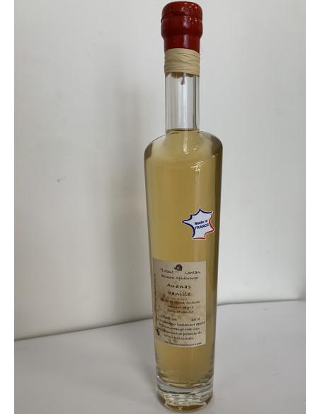 Etiquette adhésive made in France collée sur une bouteille en verre